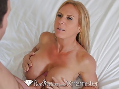 Brooke Tyler shows off her massive tits - PureMature